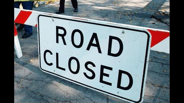 Road Work Shuts Down Lane In Rogers