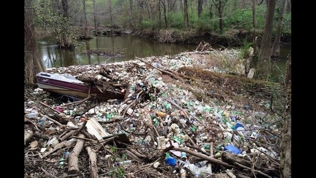 Massive Pile of Trash Builds on Creek Bed
