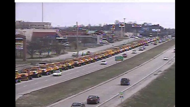 PHOTO: Public Works Trucks Stretch Across Highway in Funeral Procession for City Director